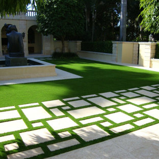 Photo of a large modern partial sun courtyard concrete paver landscaping in Tampa for summer.