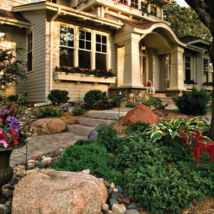 Photo of a large farmhouse front yard brick landscaping in Minneapolis.