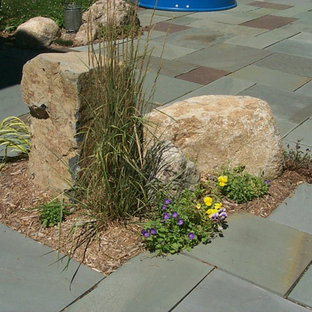 This is an example of a southwestern drought-tolerant backyard concrete paver garden path in Grand Rapids.