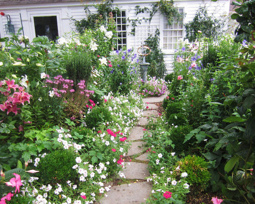 inspiration for a shabby chic style backyard landscape in boston with natural stone pavers