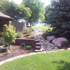 Traditional Landscape by Sharp Landscaping Inc.