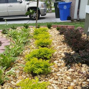 Inspiration for a small modern full sun front yard gravel formal garden in Orlando.