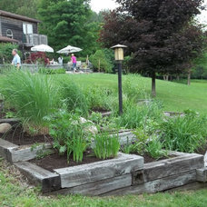 Traditional Landscape by Snow Hill Inc