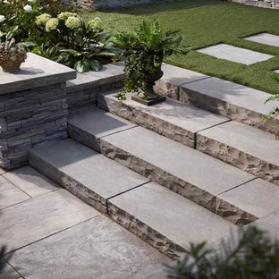 Inspiration for a contemporary backyard concrete paver landscaping in Ottawa.