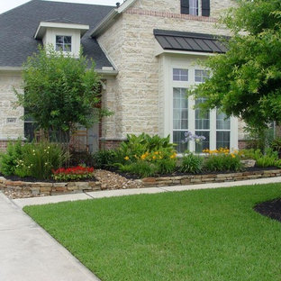 Photo of a mid-sized traditional partial sun front yard concrete paver landscaping in Houston.