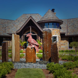 Large Estate Fountains - Custom pond-less water feature with 5 unique basalt column fountains and Imperial Red granite carved cardinal centerpiece.  Basalt column fountains range from 3 to 7 feet tall.  Contact us for more information on custom configurations.  ~ Carved Stone Creations, Inc.