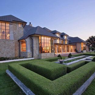 Photo of a huge victorian full sun backyard landscaping in Austin.