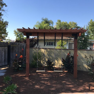 This is an example of a mid-sized shade backyard mulch formal garden in Other.