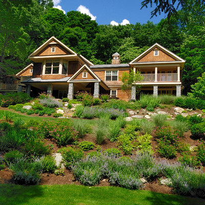 This is an example of a mid-sized rustic partial sun backyard mulch formal garden in New York.
