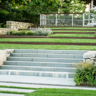 Inspiration for a large contemporary full sun hillside concrete paver landscaping in New York.
