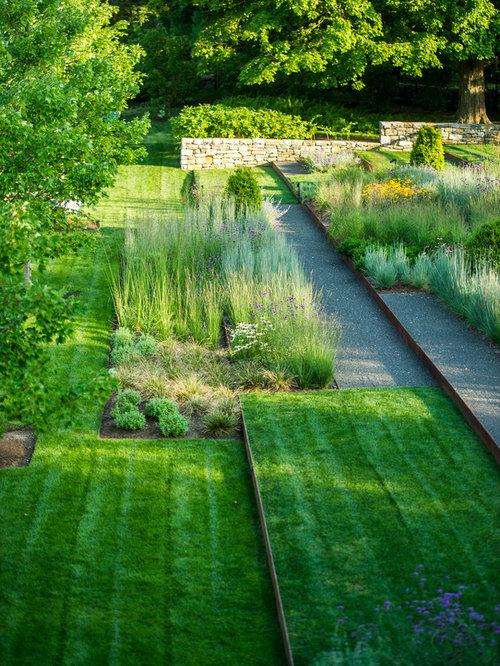 Photo Of A Mid Sized Contemporary Partial Sun Backyard Concrete Paver  Formal Garden In New