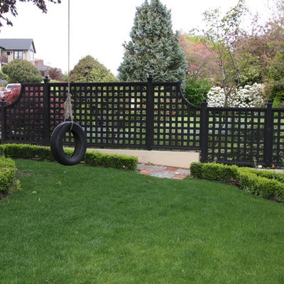 Inspiration for a large traditional full sun front yard stone landscaping in Seattle.