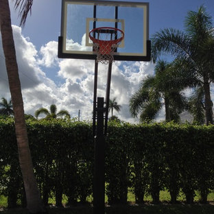 Design ideas for a large traditional partial sun backyard outdoor sport court in Miami.