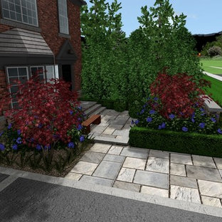 This is an example of a mid-sized modern partial sun front yard stone garden path in Other for summer.
