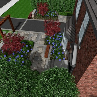 Inspiration for a mid-sized modern partial sun front yard stone garden path in Other for summer.