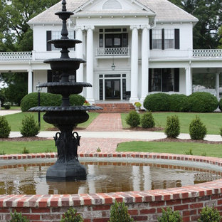 Design ideas for a traditional full sun backyard brick landscaping in Jackson.