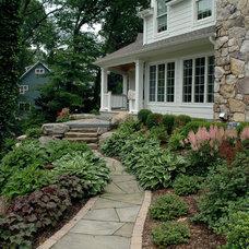 Traditional Landscape by Jardin Passion Landscape Designers