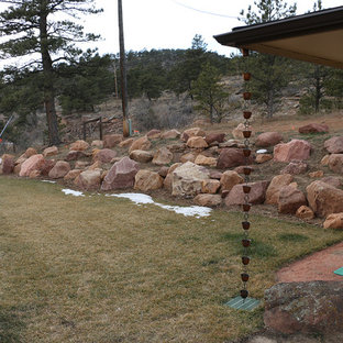 Photo of a large southwestern partial sun front yard stone landscaping in Denver for summer.
