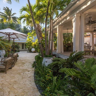 Inspiration for a large tropical side yard landscaping in Miami.