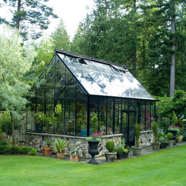 Lightheart Greenhouse - Our Cape Cod Greenhouse from our Cross Country line.  This is a 12x16 black frame with upgraded doors in the sidewall, decorative gutter and beautiful ridge cresting.  Extra high sidewalls create a larger interior space and double doors in the sidewall offer easy access for larger planters, wheelbarrows or living furniture.