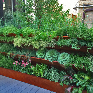 Photo of a small contemporary full sun rooftop vegetable garden landscape in Chicago.