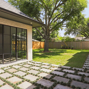 This is an example of a huge transitional partial sun backyard stone landscaping in Houston for summer.