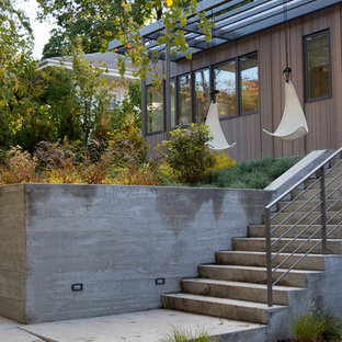 This is an example of a contemporary retaining wall landscape in Boston.