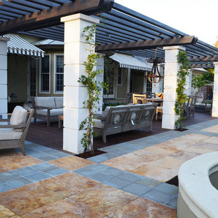 This is an example of a large transitional partial sun backyard landscaping in San Francisco with a fire pit and decking.