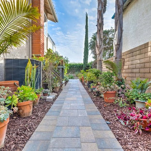 Photo of a small craftsman backyard concrete paver landscaping in Los Angeles with a fire pit.