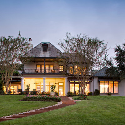 Inspiration for a huge traditional backyard landscaping in New Orleans.