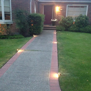 Photo of a small midcentury modern full sun front yard brick garden path in Seattle for winter.