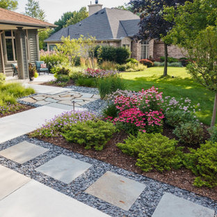 Inspiration for a mid-sized modern drought-tolerant and full sun front yard stone garden path in Milwaukee for summer.