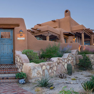 This is an example of a southwestern full sun brick garden path in Albuquerque.