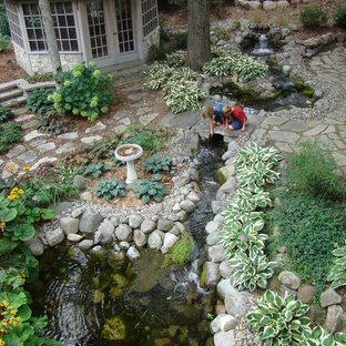 Inspiration for a traditional water fountain landscape in Minneapolis.