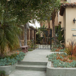 Design ideas for a mid-sized tropical drought-tolerant and partial sun front yard concrete paver landscaping in Los Angeles.