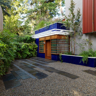 Inspiration for a large contemporary partial sun courtyard gravel landscaping in Boston.