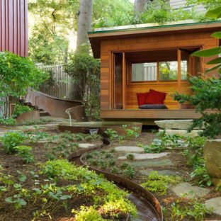 This is an example of a contemporary full sun backyard stone water fountain landscape in Boston.