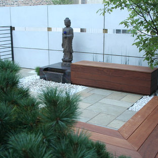 Inspiration for a mid-sized asian backyard stone landscaping in Chicago.