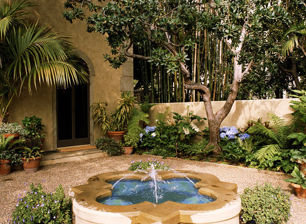 Mediterranean Landscape by Tommy Chambers Interiors, Inc.