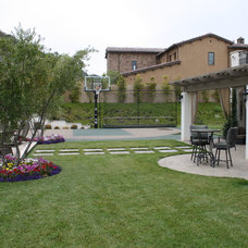 Traditional Landscape by Green Scene Landscaping & Pools