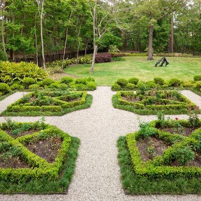 Photo of a huge mediterranean backyard gravel formal garden in Houston.