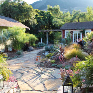 Photo of a mediterranean xeriscape garden in San Luis Obispo with natural stone paving.