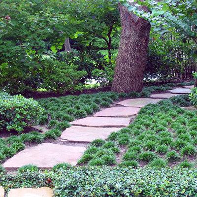 Photo of a mediterranean backyard stone landscaping in Houston.