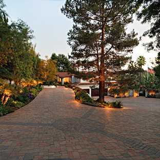 Mediterranean driveway in Orange County with natural stone pavers.