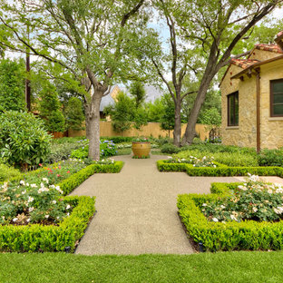 This is an example of a small mediterranean privacy courtyard formal garden in Dallas.