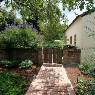 Design ideas for a mediterranean side yard landscaping in Other.
