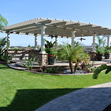 Traditional Landscape by Affordable Landscaping Solutions