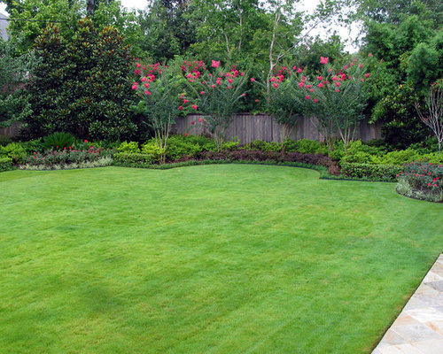 This Is An Example Of A Mediterranean Backyard Garden In Houston.