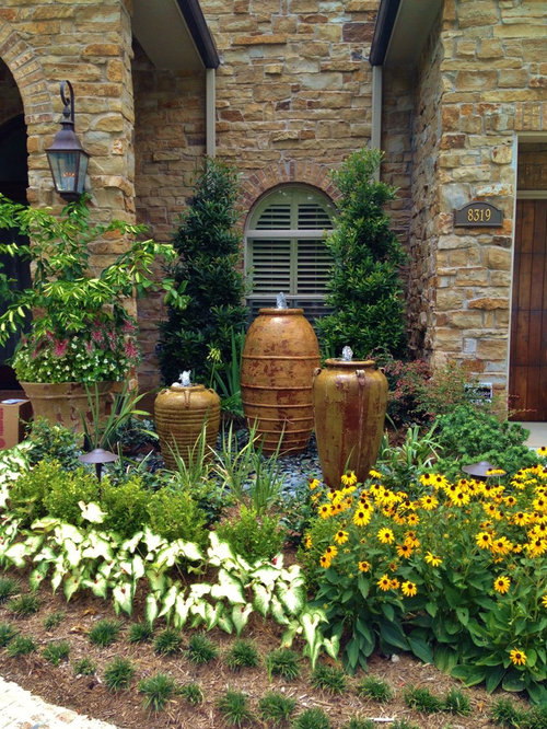 photo of a large mediterranean full sun front yard gravel landscaping in houston for summer - Front Yard Landscape Design Ideas