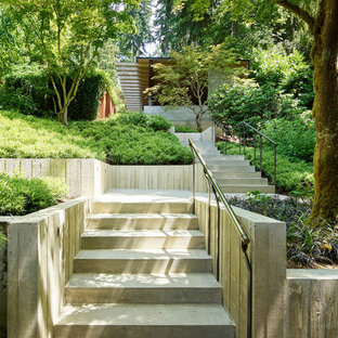 Design ideas for a contemporary front yard concrete paver retaining wall landscape in Seattle.